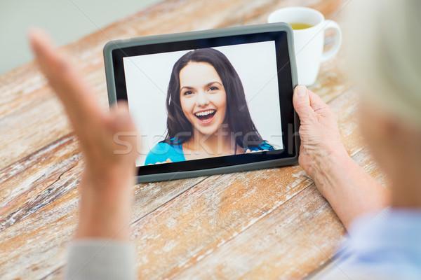 senior woman with photo on tablet pc at home Stock photo © dolgachov