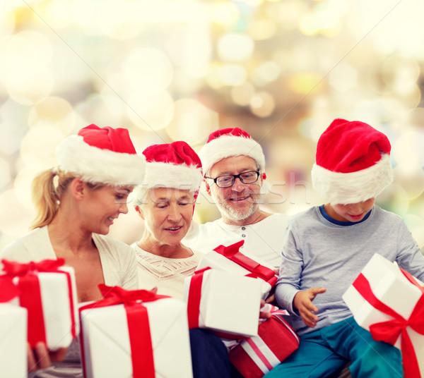 happy family in santa helper hats with gift boxes Stock photo © dolgachov