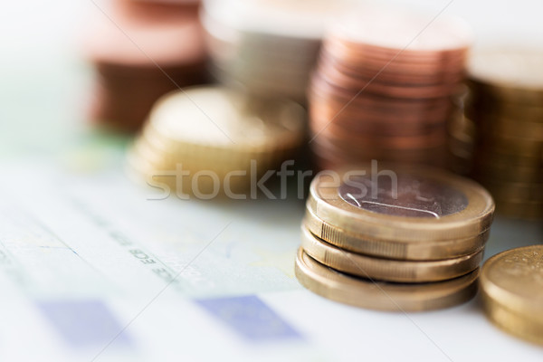 close up of euro paper money and coins on table Stock photo © dolgachov