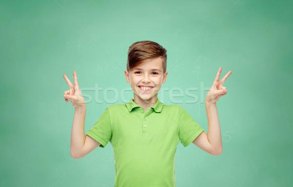 Paix victoire signe de la main geste Photo stock © dolgachov