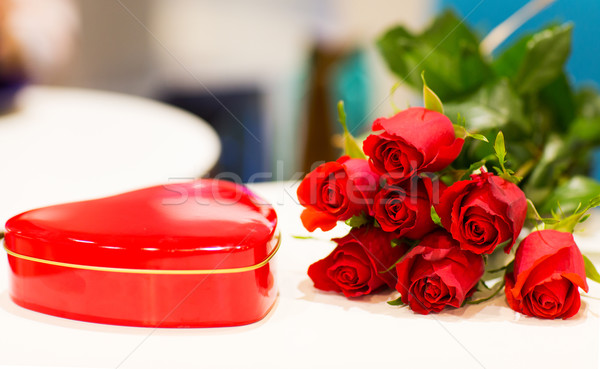 close up of chocolate box and red rose flowers Stock photo © dolgachov