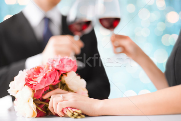 happy engaged couple with flowers and wine glasses Stock photo © dolgachov