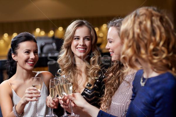 Feliz mulheres champanhe óculos boate celebração Foto stock © dolgachov