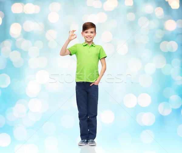 Branco tshirt sinal da mão Foto stock © dolgachov