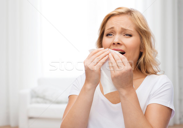 unhappy woman with paper napkin sneezing Stock photo © dolgachov