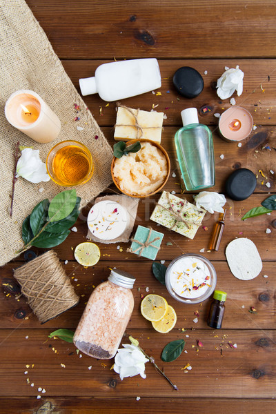 Stock photo: close up of body care cosmetic products on wood