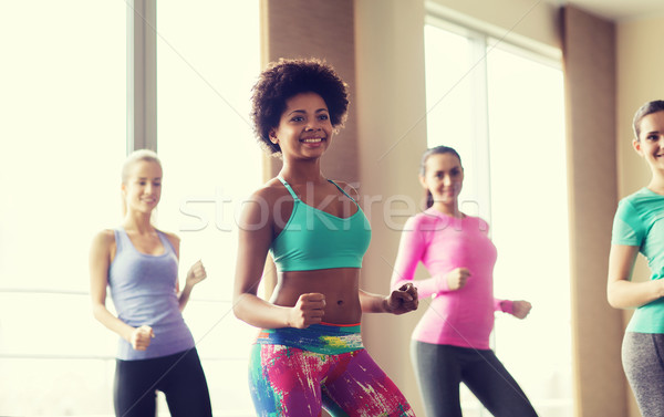 group of smiling people dancing in gym or studio Stock photo © dolgachov