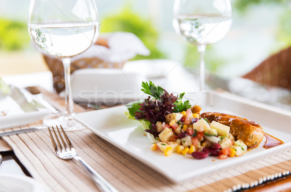 close up of food and water glasses at restaurant Stock photo © dolgachov