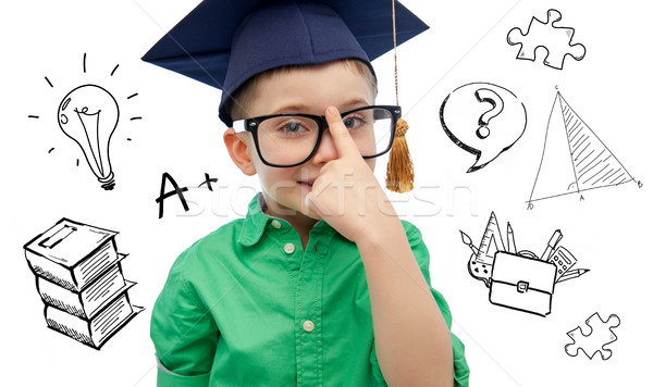 boy in bachelor hat and eyeglasses over doodles Stock photo © dolgachov