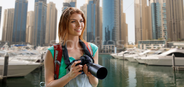 woman with backpack and camera over dubai city Stock photo © dolgachov