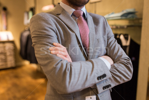 close up of man in suit and tie at clothing store Stock photo © dolgachov