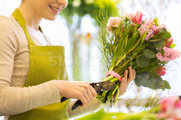 close up of florist woman with flowers and pruner Stock photo © dolgachov