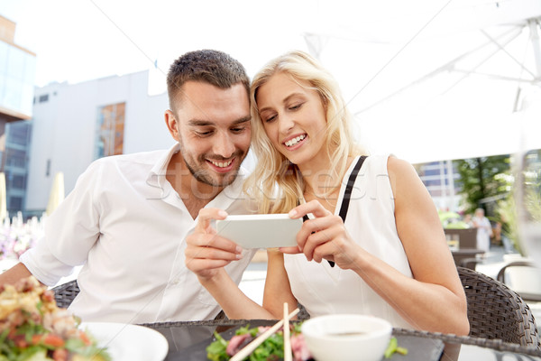Gelukkig paar restaurant terras liefde datum Stockfoto © dolgachov