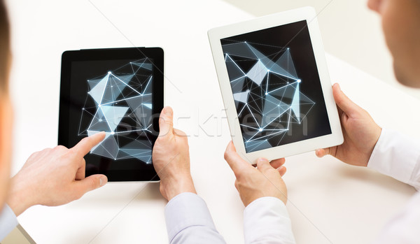 Stock photo: close up of businessman hands with tablet pc