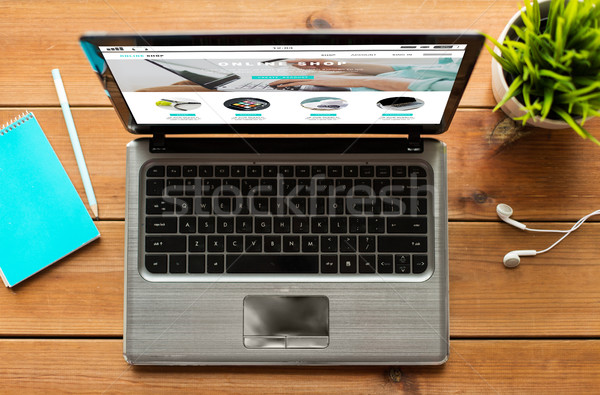 close up of laptop computer with online shop page Stock photo © dolgachov