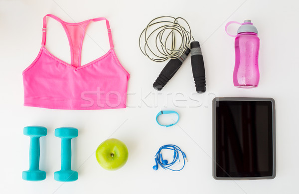 close up of tablet pc computer with sports stuff Stock photo © dolgachov