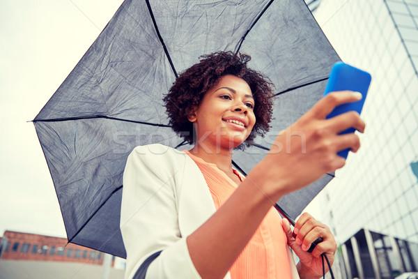 Işkadını şemsiye iş kötü hava Stok fotoğraf © dolgachov