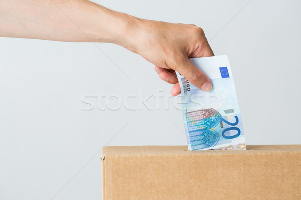 man putting euro money into donation box Stock photo © dolgachov