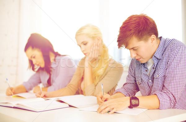 Cansado estudiantes cuadernos escuela educación grupo Foto stock © dolgachov