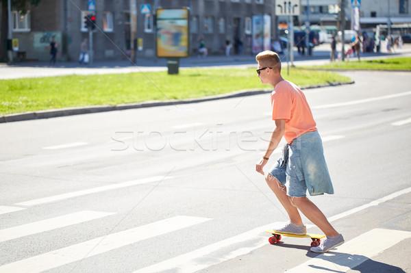 teenage boy on skateboard crossing city crosswalk Stock photo © dolgachov