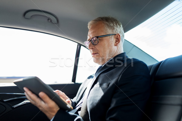 senior businessman with tablet pc driving in car Stock photo © dolgachov