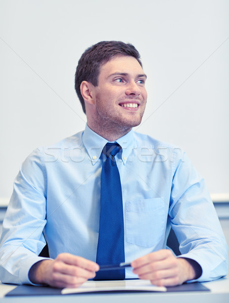 Stock photo: smiling businessman sitting in office