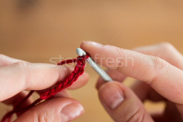close up of hands knitting with crochet hook Stock photo © dolgachov