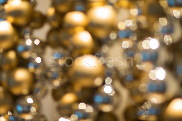 Arany karácsony dekoráció girland gyöngyök ünnepek Stock fotó © dolgachov