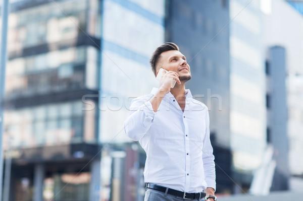 happy man with smartphone calling on city street Stock photo © dolgachov