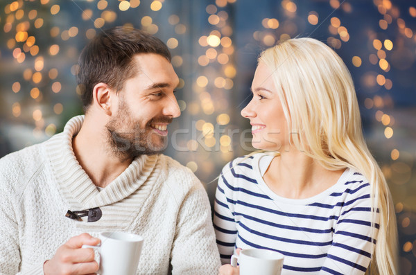 Stock photo: happy couple drinking tea or coffee at cafe
