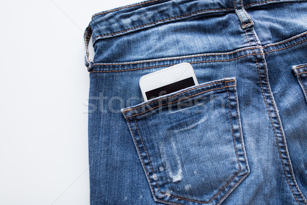 smartphone in pocket of denim pants or jeans Stock photo © dolgachov