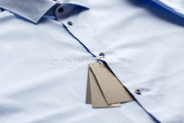 close up of shirt with price tag Stock photo © dolgachov