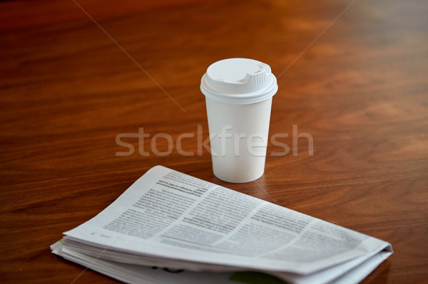 coffee drink in paper cup and newspaper on table Stock photo © dolgachov
