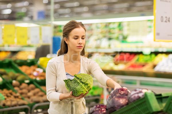 happy woman buying savoy at grocery store Stock photo © dolgachov