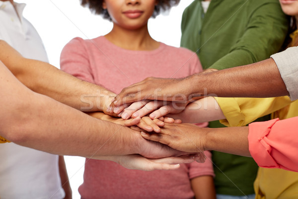 group of international people with hands together Stock photo © dolgachov
