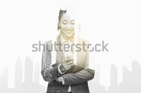 Sorridente empresária olhando pessoas de negócios tecnologia Foto stock © dolgachov