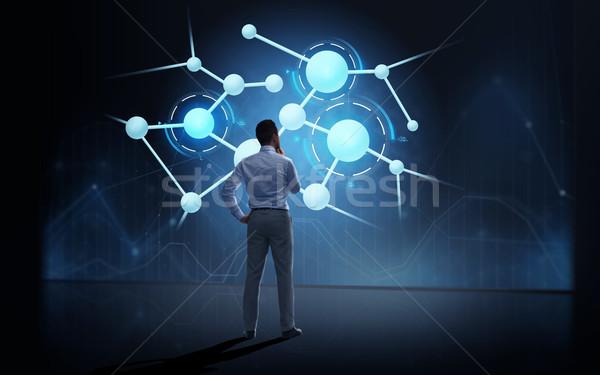 Zakenman naar virtueel projectie zakenlieden technologie Stockfoto © dolgachov