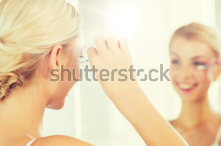 Femme salle de bain beauté Photo stock © dolgachov