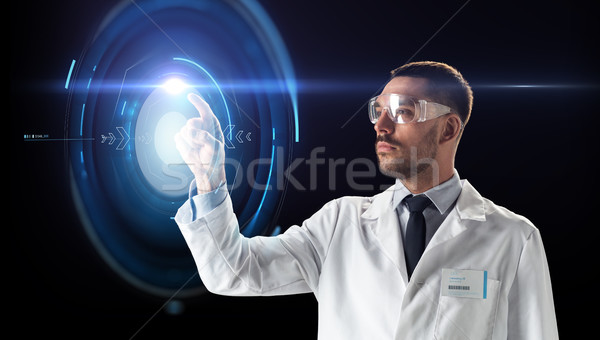 scientist in goggles with virtual projection Stock photo © dolgachov
