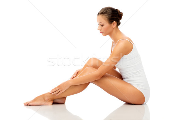 beautiful woman touching her smooth bare legs Stock photo © dolgachov