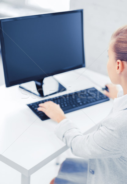 Stock photo: businesswoman with computer in office