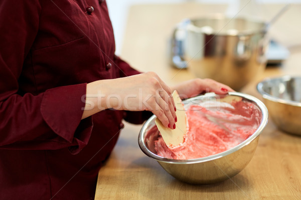 chef making macaron batter at confectionery Stock photo © dolgachov