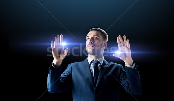 Işadamı lazer ışık siyah iş adamları gelecek Stok fotoğraf © dolgachov
