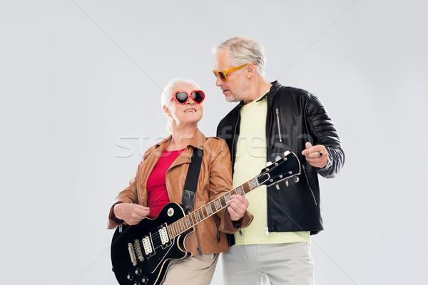 senior couple in sunglasses with electric guitar Stock photo © dolgachov