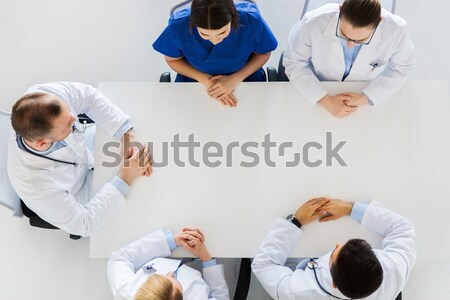 doctor showing something imaginary on table Stock photo © dolgachov
