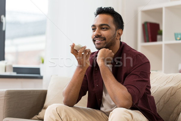 Stock photo: man using voice command recorder on smartphone