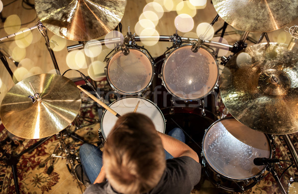 musician or drummer playing drum kit at studio Stock photo © dolgachov