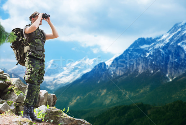 soldier with backpack looking to binocular Stock photo © dolgachov