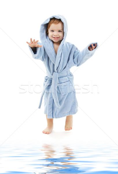 Bebê menino azul robe branco água Foto stock © dolgachov