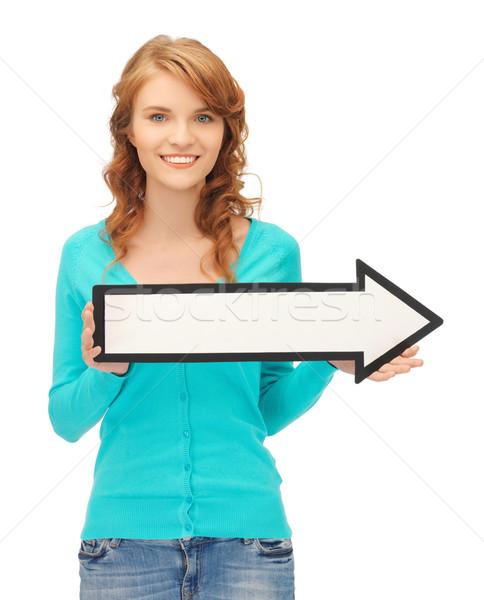 Genç kız yön ok işareti resim çekici kadın Stok fotoğraf © dolgachov